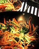 Vegetable trio: carrots, leeks, and broccoli in wok