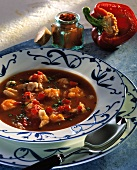Hungarian fish soup with red pepper and paprika