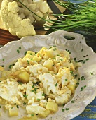 Cauliflower with egg sauce, potatoes and chives
