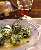 Spinach dumplings with fresh parmesan in butter sauce