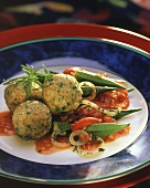 Green rye dumplings with okra, summer savory and tomatoes