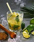Caipirinha with lime wedges and ice cubes