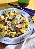 Herb-marinated meat with mustard mousse & broad ribbon noodles