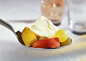 Fresh fruit with orange dip on spoon