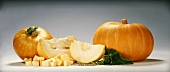 Two pumpkins, sliced and diced pumpkin