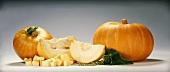 Two pumpkins, sliced and diced pumpkin