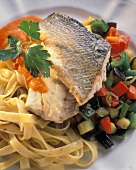 Baked Sea Bass on a Bed of Fettucine and Vegetables