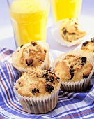 Blueberry Muffins in Paper Cups with Orange Juice
