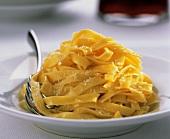 Tagliatelle al formaggio (Ribbon pasta with Parmesan, Italy)