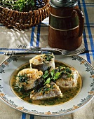 Hake in brown beer sauce with herbs; tankard