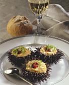 Sea urchin with scrambled egg; White wine glass; Roll