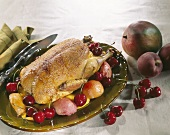 Roast duck with peach, mango and cherries