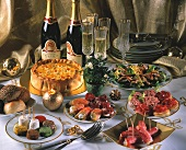 New Year's Eve buffet with snacks, salad, cake and champagne