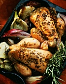 Roast poussin with fennel seeds & vegetables in roasting tin