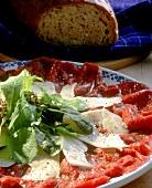Beef carpaccio with Parmesan curls; bread