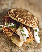 Trout and bacon pancakes with sour cream and chives