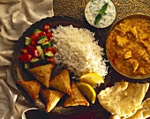 Indian pasties with rice; stew; dip and flatbread