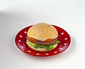 A hamburger on red plate with white stars