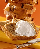 Banana loaf, sliced, with cream cheese