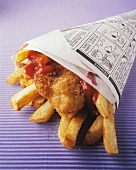 Fish and chips with ketchup in newspaper bag
