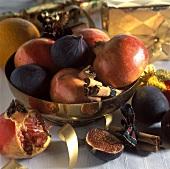 Fresh fruit in a golden bowl; Christmas décor