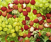 Green grapes and lychees with flowers in among