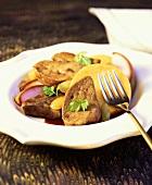 Sautéed goose liver on polenta with poached pear