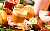 Orange and apple juice, yoghurt with strawberries, milkshake