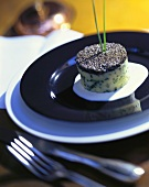 Potato cake with caviare with chives and yoghurt sauce