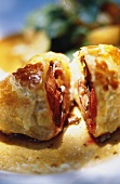 Pigeon and goose liver in puff pastry on plate