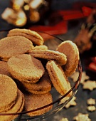 Crisp almond biscuits in glass bowl for Christmas