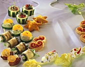Various vegetarian snacks on a marble platter