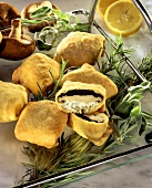 Mushrooms in pastry with herb stuffing on tray; rosemary