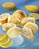 Lemon sponge rolls on a glass plate