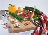 Still life with vegetables, mushrooms, chives on chopping board