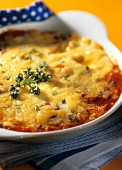 Spanish eggs with tomatoes and herbs in gratin dish