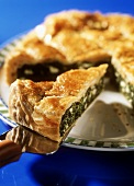 Greek spinach pie on server and plate