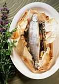 Trout with shallots & herbs on greaseproof paper