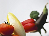 Tomato and chicory in front of pepper, aubergine & broccoli