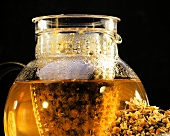 Camomile tea in a glass jug