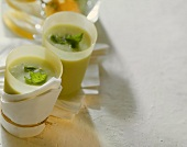 Soft green drink with avocado and lemon balm in two glasses