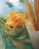 Millet spaghetti, strips of carrot, carrot leaves & sesame