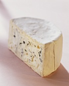 Blue cheese, piece cut, on light background