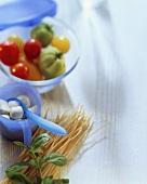 Still life with tomatoes, mozzarella, spaghetti, basil