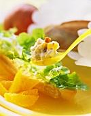 Salad sandwich, fruit quark on spoon above it