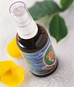 Rose-water spray in small bottle & yellow rose petals