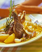 Marinated lamb cutlets with potatoes and rosemary sprig