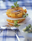 Maties in potato crust with coriander leaves & forks
