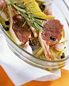 Marinated lamb cutlets with oil, spices etc in roasting dish