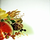 Still life with water melon, artichoke, ears of corn, nuts etc